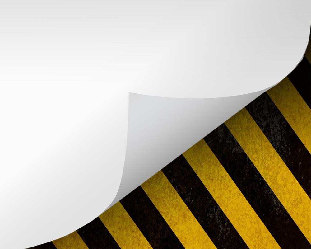 Warning sign hidden under a paper layer.