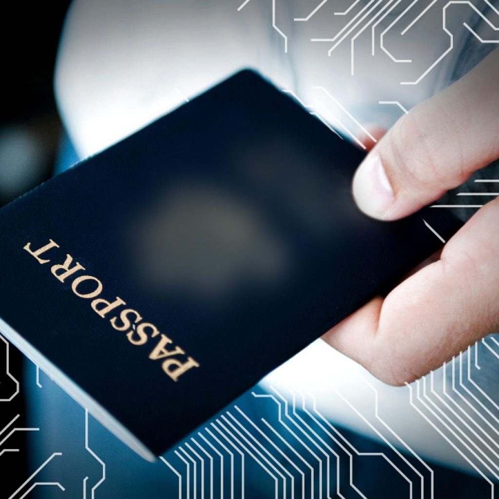 Image of a man holding a passport.
