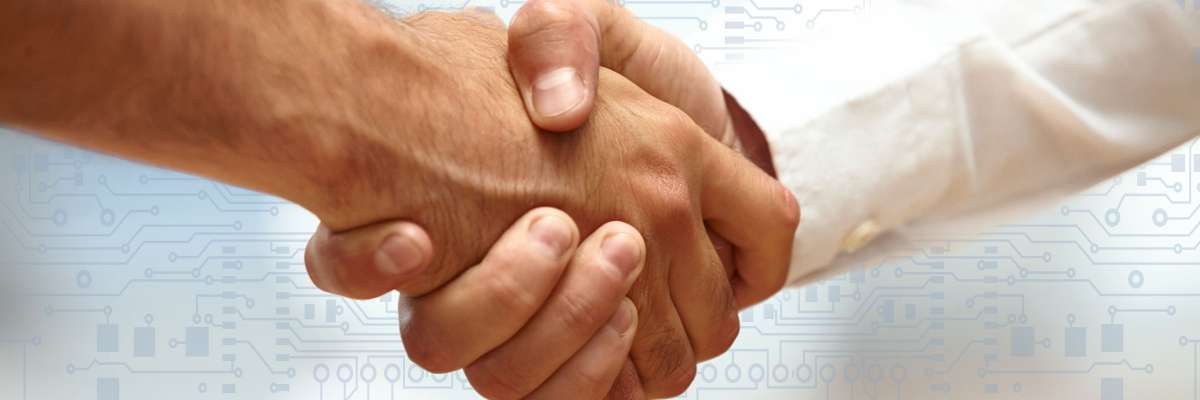 Business partners shaking hands.