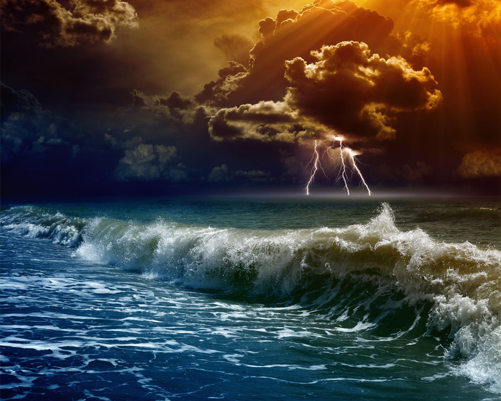 Photo of ocean storm with large waves and lightning.